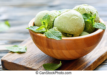 Homemade mint ice cream. - Balls mint ice cream in bowl on...