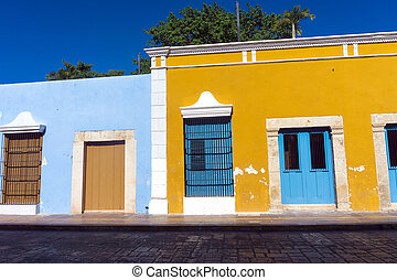 Yellow and Blue Colonial Architecture - Yellow and blue...