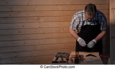 Senior carpenter tighten the screw - Senior carpenter...