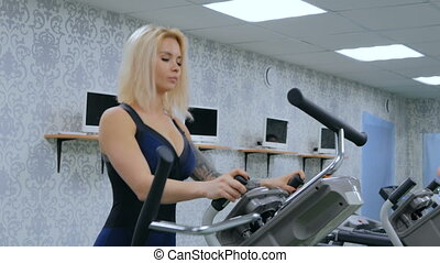 3 shots. Athletic young woman working out on stepper machine...