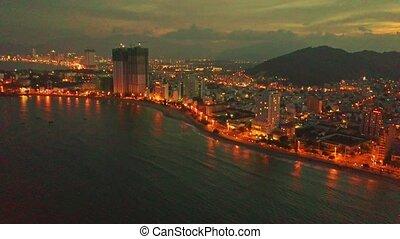 Drone Approaches Skyscraper in Ocean Resort City on Seaside...