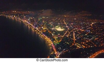 Flycam Shows Panoramic View of Night City on Seaside