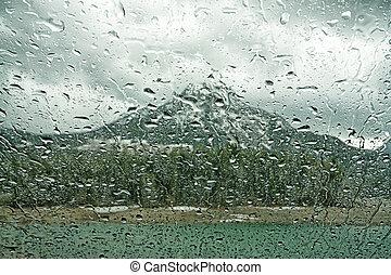 Mountain Rain on the Windshield - Macro of rain on a...