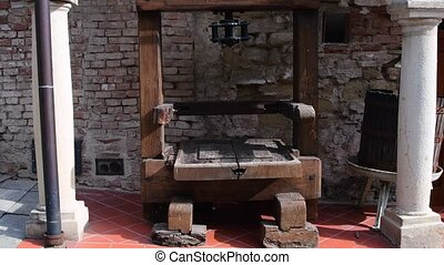 Historical wine press at historic courtyard. - Historical...