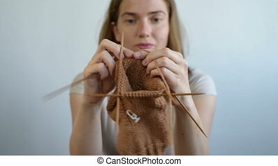 Young woman knitting a sock - Close up of a woman knitting a...