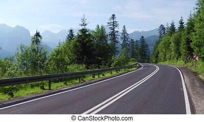Spectacular view to the Tatra mountains from the curvy car...