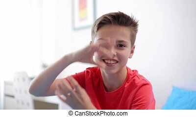 happy smiling preteen boy talking at home - people,...