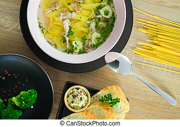 noodles on a plate with bread