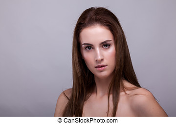 Beauty portrait of woman with no makeup on gray background...