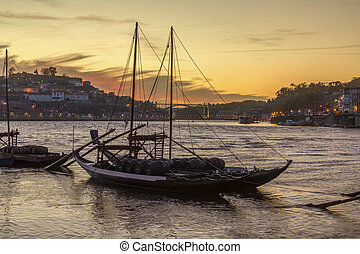 Porto (Oporto) in Portugal - Port Wine boats moored on the...