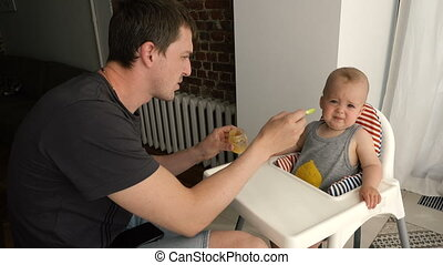 Father feeding infant son