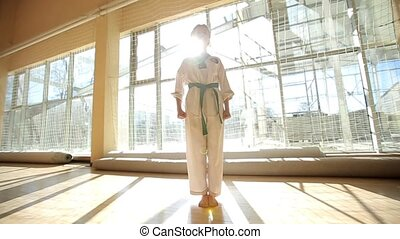 Karate kick girl in kimono practice technical shots - Karate...