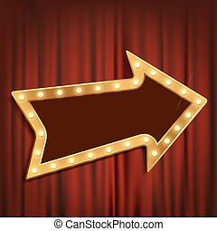 Golden arrow with light bulbs on the red theatrical curtain.