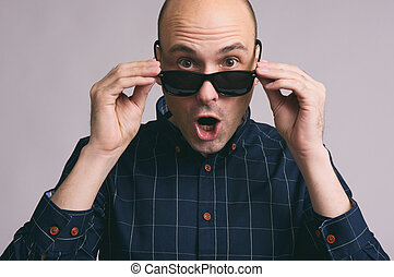 shocked young man wearing sunglasses