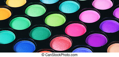 Colorful eye shadows palette. Makeup background. Close up