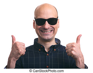 Bald guy shows thumbs up. Isolated