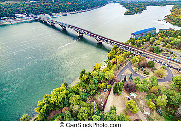 aerial photo of Dnipro and bridge across it in Kyiv -...