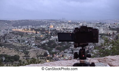 Camera shoots photo of the Jerusalem Old City - Camera...