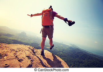 successful woman hiker enjoy the view hiking on mountain...