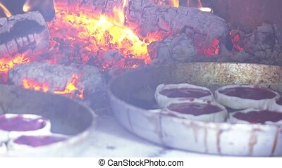 Open cheesecake in oven - The furnace is preparing Perepech...