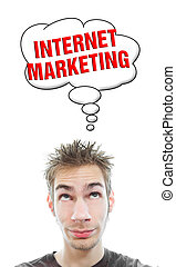 Young man thinks about internet marketing - Young white...
