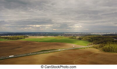 Aerial drone shot of countryside view. Copter flying over...