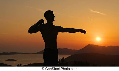 Young man training on sunset