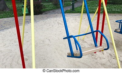 an empty swing moves