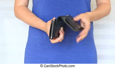 woman shows her empty wallet. Bankruptcy. Bankruptcy -...