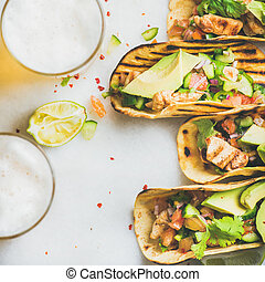 Healthy corn tortillas with chicken, vegetables, limes,...