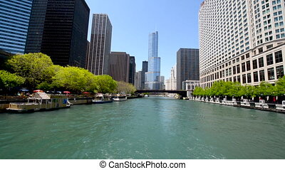 Moving Down Chicago River - Passing by skyscrapers on the...