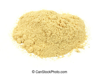 Small pile of sawdust - A small amount of sawdust on a white...