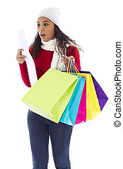 Shopping surprise - Stock image of surprised woman looking...