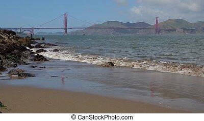 Golden Gate Bridge in San Francisco, California. Sandy beach...