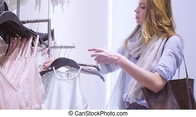 Young woman choosing underwear in a clothing store 4K