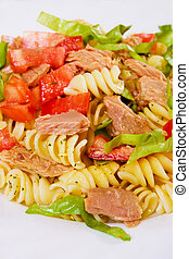 Pasta salad with tuna meat, tomato and lettuce