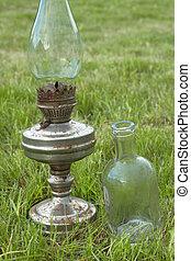 Old kerosene lamp and bottle - Glass bottle and old kerosene...
