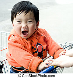 a cute baby is laughing to photographer - laughed baby