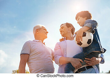 Energetic healthy family gathering for a game - Lifelong...