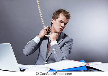 Suicide - A young businessman tightens the noose on