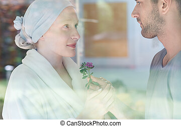 Man giving flower to woman - Handsome man giving fresh...