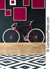 Pink bicycle against wall - Pink retro bicycle standing...
