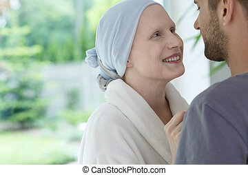 Happy woman looking at husband - Young happy woman feeling...