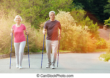 Happy nice couple walking in the countryside