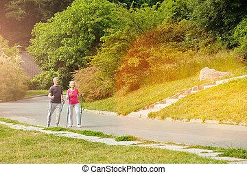 Active elderly couple enjoying Nordic walking