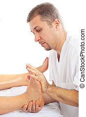 Orthopedist man massaging foot - Orthopedist man massaging...