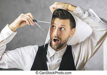 Crazy architect measuring his head with a compass on...