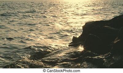 Golden evening at Lake Como in Italy. - Evening rocky beach....