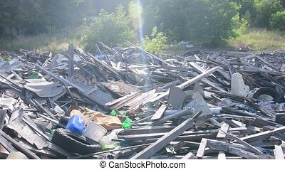 Waste dump in the town. View of garbage dump among block of...
