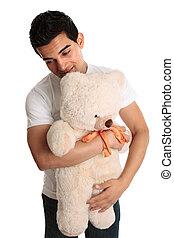 Man hugging a teddy